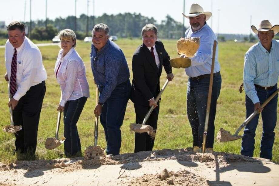 From left, state Sen. Tommy Williams, Tomball Mayor Gretchen Fagan, state Rep. Allen Fletcher, U.S. Rep. Michael McCaul, Harris County Precinct 4 Commissioner R. Jack Cagle and Montgomery County Precinct 2 Commissioner Craig Doyal break ground for the new 249 Tollway on Wednesday in Tomball. The event, hosted by the Greater Tomball Area Chamber of Commerce, marked the beginning of the $335 million improvement to SH 249. To view this photo and others like it, go online to HCNPics.com.