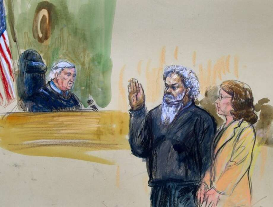 This artist's rendering shows United States Magistrate, Judge John Facciola, swearing in the defendant, Libyan militant Ahmed Abu Khatallah, wearing a headphone, as his attorney Michelle Peterson looks on during a hearing at the federal U.S. District Court in Washington Saturday.
