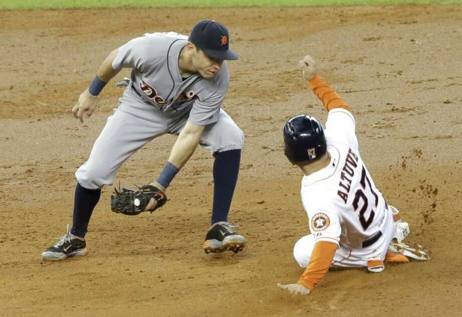The Astros' Jose Altuve steals second base as Detroit Tigers second baseman Ian Kinsler takes the throw. The Tigers won 4-3. Photo: Pat Sullivan