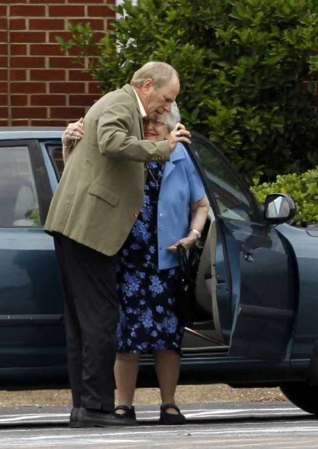 Two people embrace as they arrive to a funeral service for Cooper Harris at the University Church of Christ on Saturday in Tuscaloosa, Ala.