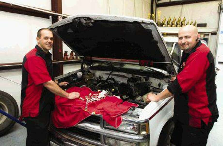 NHRA racers Travis Nicholson and Shane Conway opened Rolling Right Car Care Center in Willis in January, now the owners are on the fast track to expansion. Photo: Jason Fochtman