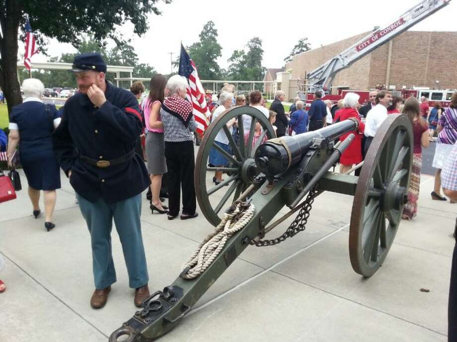 "Travis Hintzel, from the 11th Texas Light Artillery organization, participates in the ""Celebrate America"" service at Mims Baptist Church in Conroe on Sunday morning. He's pictured with a 10-pound parrot gun canon."