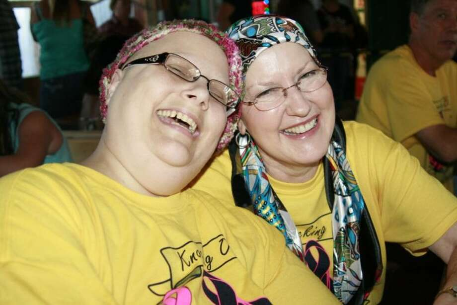 LeeAnn Elgin and Janet Winkler share a laugh at the Spirit Night/Benefit at Tin Roof BBQ Sept. 24, 2013. The benefit was organized to raise money for Elgin, Winkler and Jennifer Hollier, not pictured, who are all battling cancer.