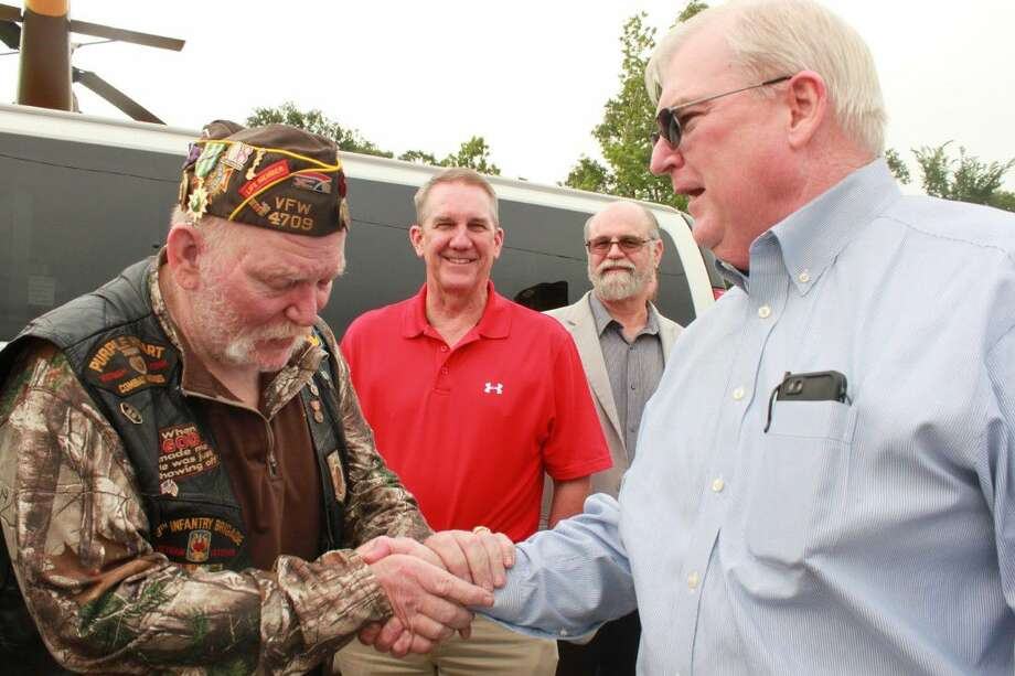 VFW Post 4709 member David Page gripped Donnie Buckalew's hand with gratitude on Wednesday in Conroe.