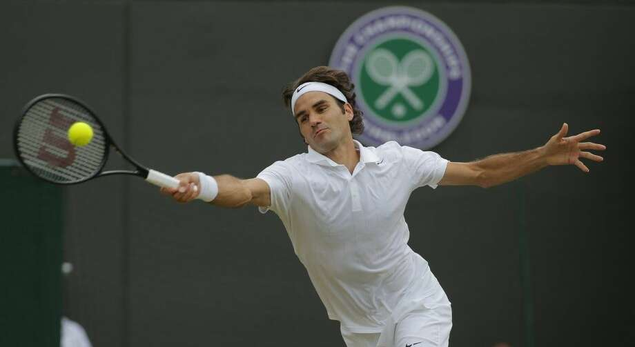 In this July 1, 2014, file photo, Roger Federer, of Switzerland, plays a return to Tommy Robredo in their men's singles match at the All England Lawn Tennis Championships at Wimbledon in London. Photo: Pavel Golovkin