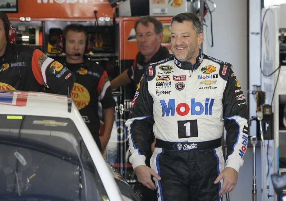 Tony Stewart walks to his car during practice for the NASCAR Sprint Cup Series Friday in Sonoma, Calif. Photo: Eric Risberg