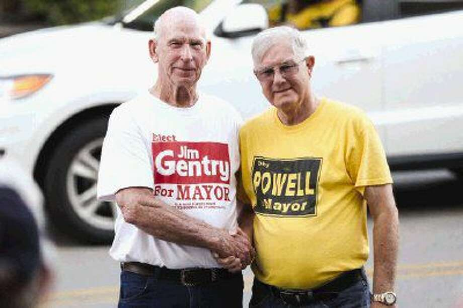 Jim Gentry, left, and Toby Powell, right, candidates for Conroe City Mayor, shake hands and pose for a photo while awaiting election results on Saturday, May 7 outside of Conroe Tower. Photo: Michael Minasi