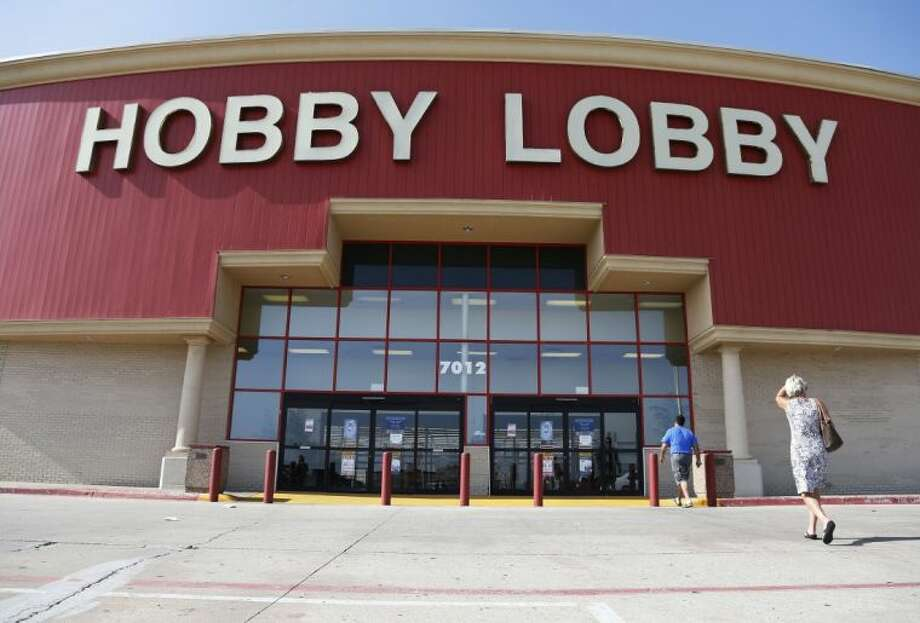 Customers walk to a Hobby Lobby store in Oklahoma City, Monday, June 30, 2014. The Supreme Court ruled Monday that employers can hold religious objections that allow them to opt out of the new health law requirement that they cover contraceptives for women. The Hobby Lobby chain of arts-and-crafts stores is by far the largest employer of any company that has gone to court to fight the birth control provision. Photo: Sue Ogrocki