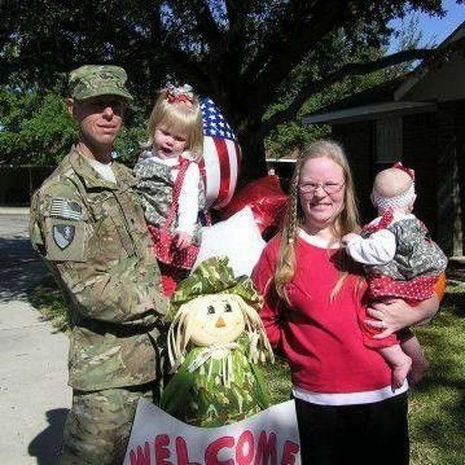 Brian Orolin, Donna Orolin and their daughters on Brian's homecoming from Afghanistan, November 4, 2011.
