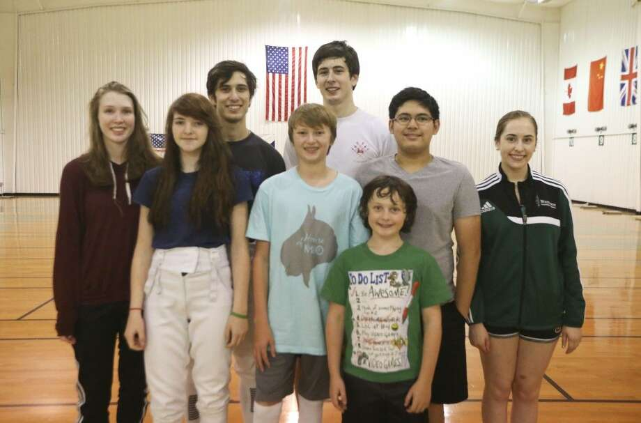 Members of the Woodlands Fencing Academy pose for a picture before leaving for nationals in San Jose, California. Front, Simon Lioznyansky. Back, from left, Christine Drake-Thomas, Summer Phillips, Ben Freiman, Cole Baker, Sam Freiman, Joseph Espinosa and Lilly Meyer. Several team members will compete in the USA Fencing Nationals starting on Saturday in San Jose, California.