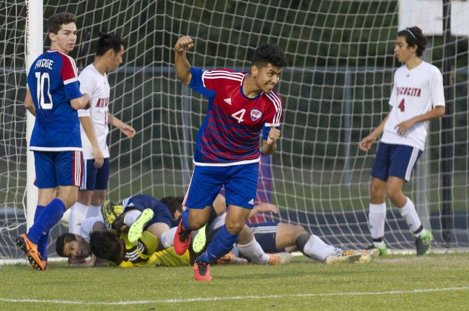Oak Ridge's Christian Treto celebrates a goal during the first period against Atascocita during a District 16-6A soccer game Saturday. Photo: Jason Fochtman