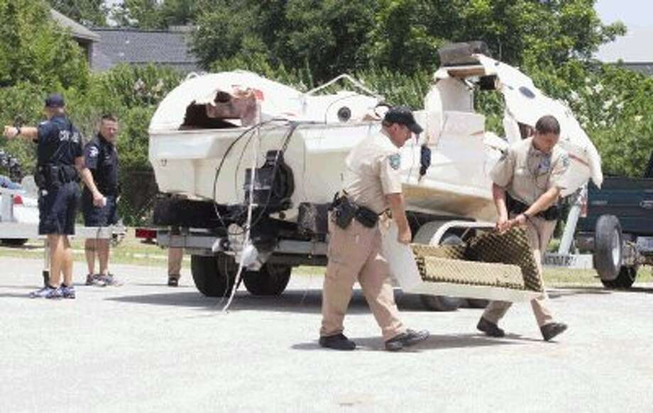 Texas Game Wardens with the Texas Parks and Wildlife Department helps transport part of a boat involved in a fatal boating accident that occurred on Tuesday evening on Lake Conroe. As of Wednesday afternoon, the two-boat incident left three victims dead.