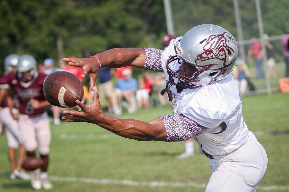Magnolia's Anthony Johnson (5) performs a practice drill before the spring football game on Saturday at Magnolia High School. Photo: Michael Minasi
