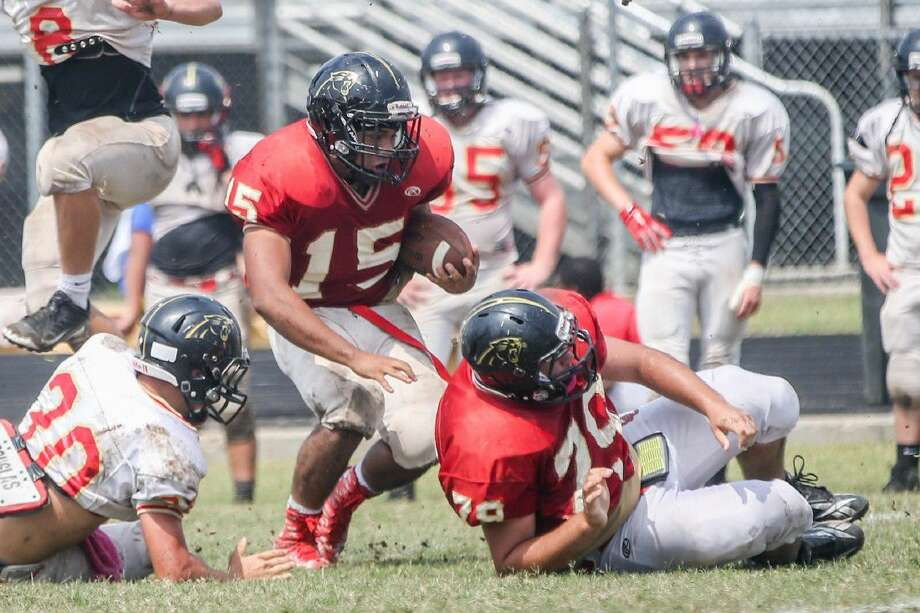 Caney Creek's Gabe Garcia (15) runs the ball during the spring football game on Saturday, May 21, 2016, at Caney Creek High School. Photo: Michael Minasi