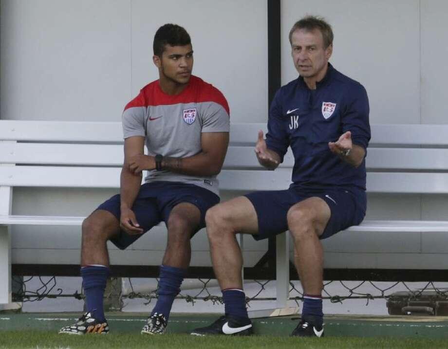 United States' coach Jürgen Klinsmann talks to DeAndre Yedlin during a training session on June 23 in São Paulo, Brazil. Photo: Julio Cortez