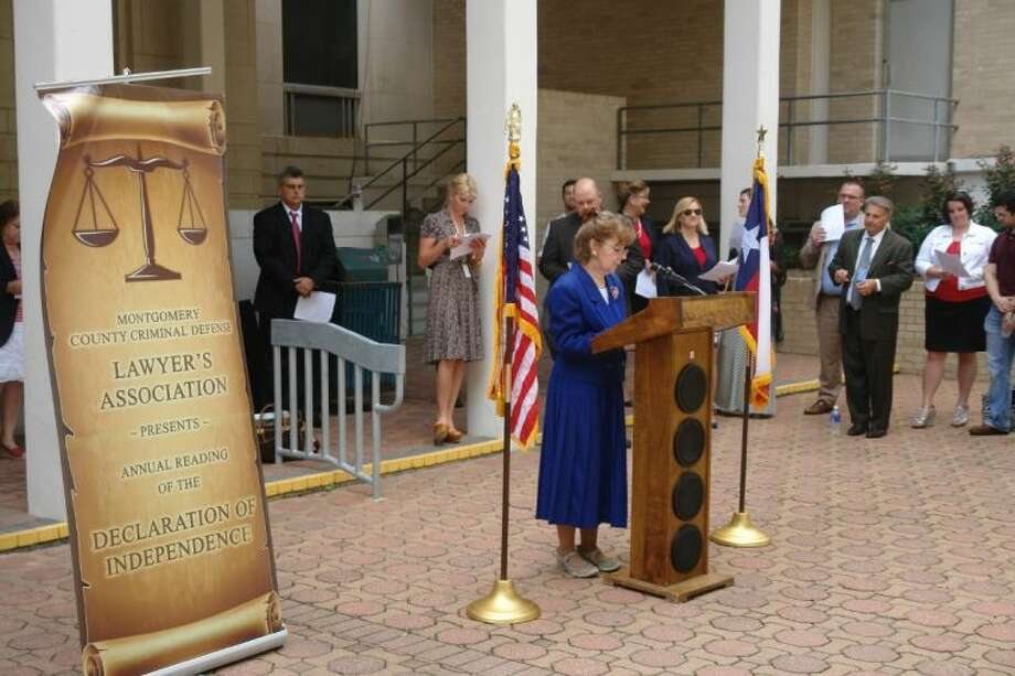 Judge Kathleen Hamilton of the 359th state District Court in Montgomery County reads part of the Declaration of Independence at a gathering on the doorsteps of the Montgomery County Courthouse on Thursday.