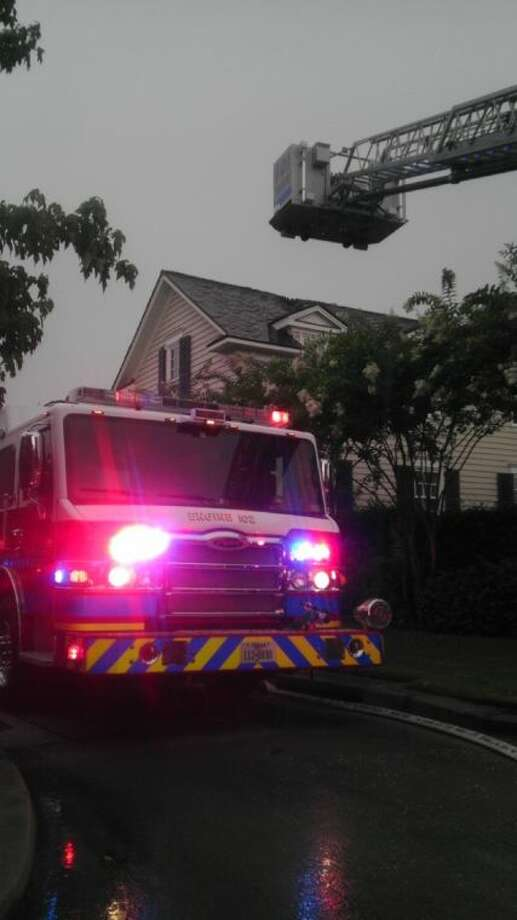A home in the East Shore community on Lake Woodlands was struck by lightning late Thursday afternoon after a wave of heavy thunderstorms swept through the area. The fire was confined to the attic of the home and no injuries were reported.