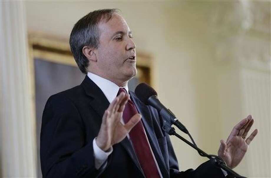 "FILE - Ken Paxton speaks in January after he was sworn in as Texas attorney general in Austin. Paxton calls the Supreme Court decision giving same-sex couples the right to marry a ""lawless ruling"" and says state workers can cite their religious objections in denying marriage licenses. He warned in a statement Sunday that any clerk, justice of the peace or other administrator who declines to issue a license to a same-sex couple could face litigation or a fine. But in the nonbinding legal opinion, Paxton says ""numerous lawyers"" stand ready to defend, free of charge, any public official refusing to grant one. Photo: Eric Gay"