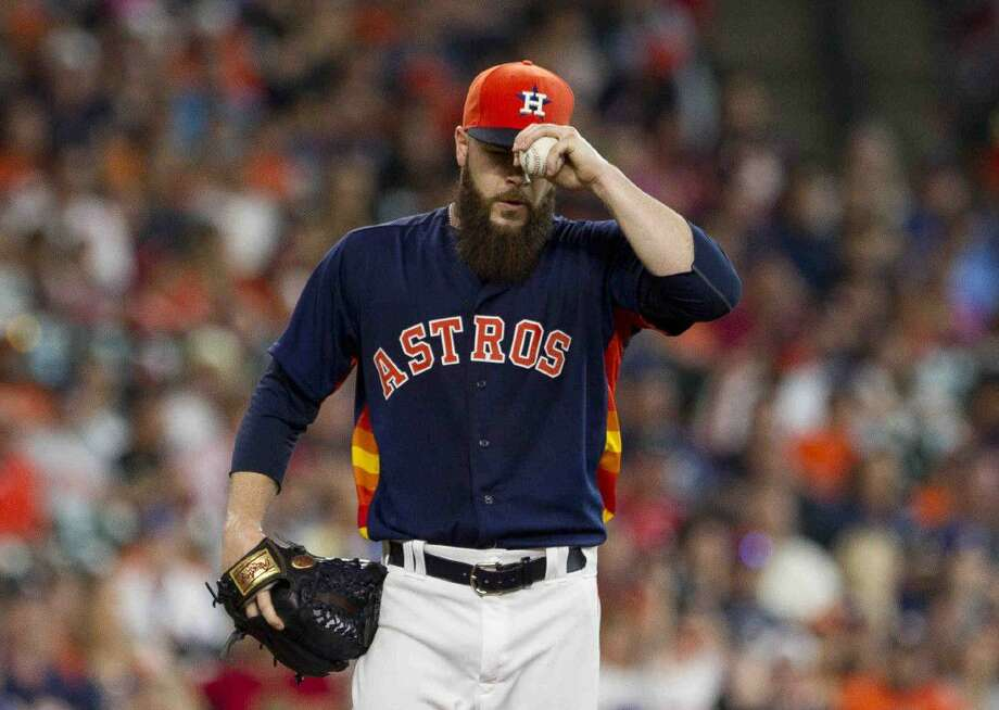 Astros pitcher Dallas Keuchel reacts after giving up a double to Adrian Beltre of the Texas Rangers during the third inning of Sunday's game in Houston. Photo: Jason Fochtman
