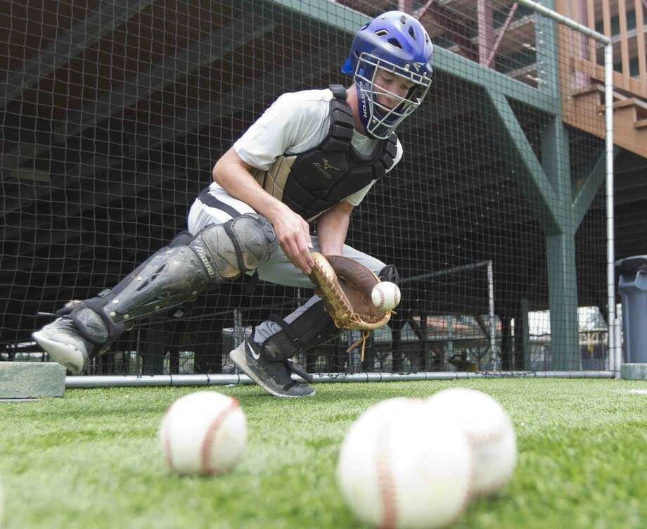 Ethan Miller works on his catching during Covenant Christian's practice at the Scrap Yard Sports complex last week. Go to HCNpics.com to view more photos from the practice. Photo: Jason Fochtman