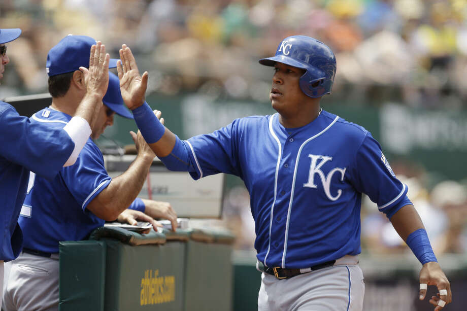Kansas City Royals' Salvador Perez, right, celebrates after scoring against the Oakland Athletics in the sixth inning of a baseball game Sunday, June 28, 2015, in Oakland, Calif. Perez scored on a single by teammate Omar Infante. (AP Photo/Ben Margot) Photo: Ben Margot
