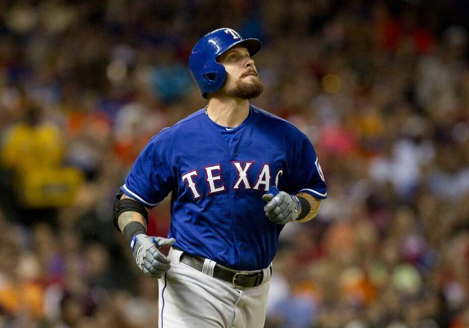 Texas Rangers outfielder Josh Hamilton will miss the entire season after more surgery on his left knee. Photo: Jason Fochtman