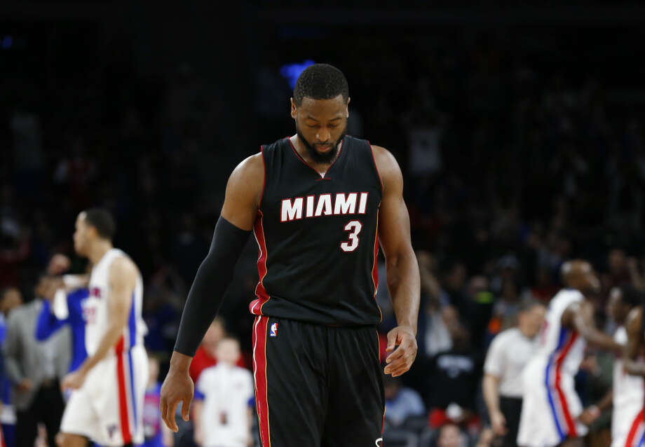 FILE - In this April, 2015 file photo, Miami Heat guard Dwyane Wade walks off the court after missing a last-second shot against the Detroit Pistons in the second half of an NBA basketball game in Auburn Hills, Mich. Wade has until the end of Monday, June 29 to tell the Miami Heat if he'll accept a $16.1 million offer for next season or become a free agent. (AP Photo/Paul Sancya, File) Photo: Paul Sancya