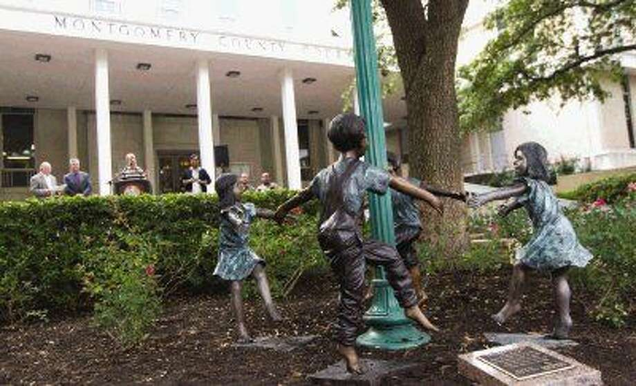 "The rejoined ""Children at Play"" statues are seen in front of the Montgomery County Courthouse Tuesday. A pair of statues, including the reunited ""Children at Play"" statue, were unveiled. Go to HCNpics.com to view more photos from the statue unveiling. Photo: Jason Fochtman"