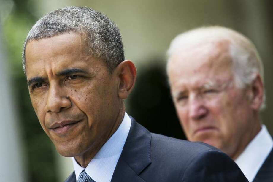This June 30 file photo shows President Barack Obama, accompanied by Vice President Joe Biden, pausing while making a statement about immigration reform in the Rose Garden of the White House.