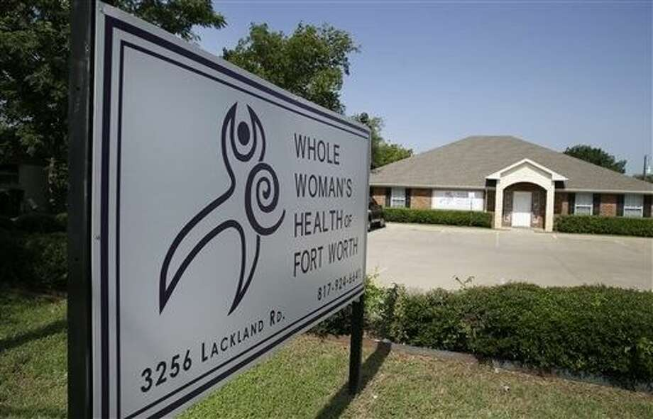 A sign marks the location of the Whole Women's Health of Fort Worth clinic, Tuesday. Texas abortion providers cheered a move by the U.S. Supreme Court to temporarily block a state law that would have closed almost half of the state's 19 remaining abortion clinics, including this health care provider. Now they are studying whether it could also allow them to reopen some previously shuttered facilities and whether that would even be feasible. Photo: LM Otero
