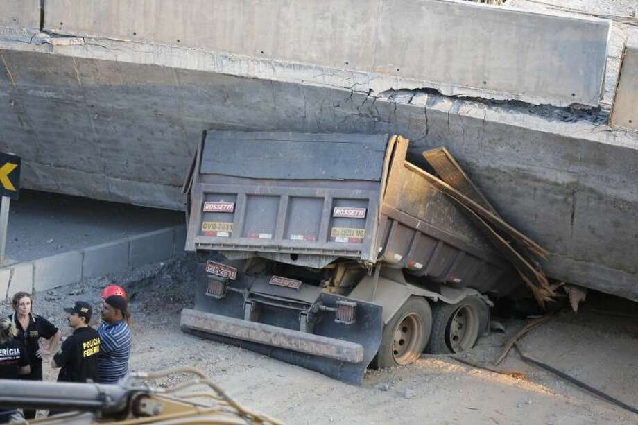 A truck is trapped underneath a collapsed overpass on Thursday in Belo Horizonte, Brazil. Photo: Victor R. Caivano