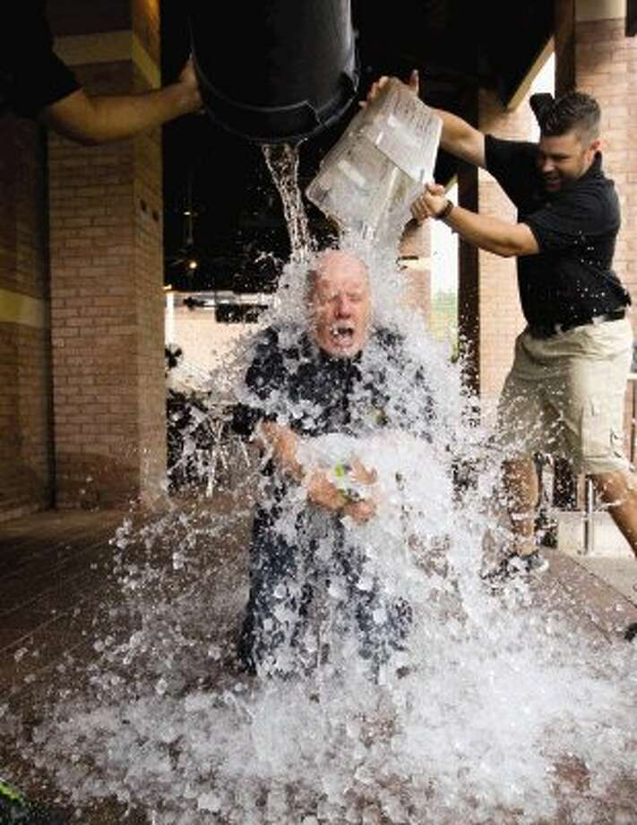 "John Hennigan goes through the ""Cold Water Challenge"" at The Gooses Acre Bistro and Irish Pub in The Woodlands June 24. Hennigan donated to the Duck Race, MCEA's annual fundraiser, and challenged four of his friends. Photo: Jason Fochtman / Conroe Courier / HCN"