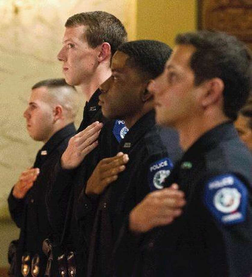 Conroe cadets take an oath during a graduation ceremony for the Conroe Police Department Thursday. Photo: Jason Fochtman