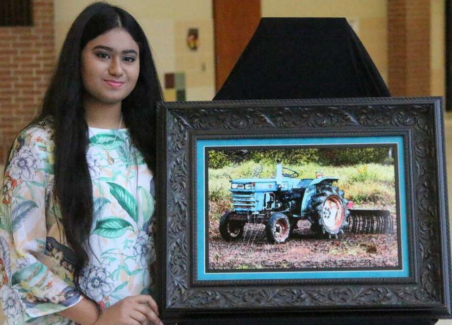 "Tasnuva Haider, this year's Congressional Art Competition winner for Texas District 8, with her winning artwork titled ""Days Gone By."""