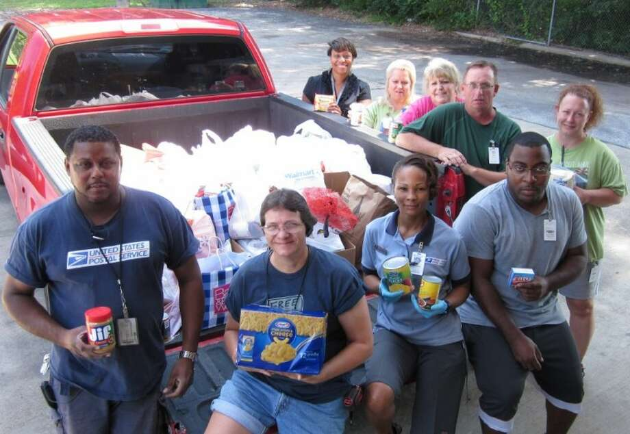 Cleveland postal carriers recently participated in the annual National Association of Letter Carriers' Stamp Out Hunger food drive, collecting an estimated 550 pounds of food donated to Cleveland's Operation Refuge food pantry. Photo: FRIEDA WHITE