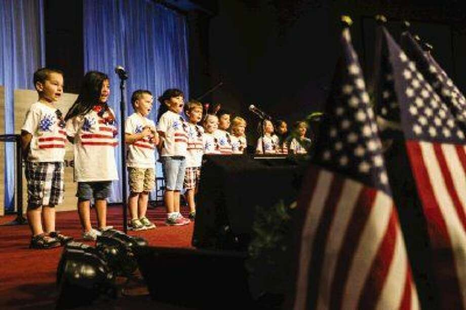 Children from The Depot Childcare Center sing God Bless America during their annual July 4th parade and program on Wednesday at First Assembly of God. To view more photos from the parade, go to HCNPics.com. Photo: Michael Minasi