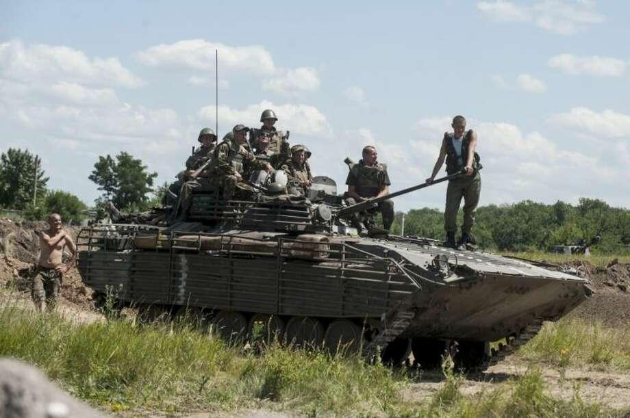 Ukrainian troops atop an APC at a checkpoint near Slovyansk, eastern Ukraine, Saturday.