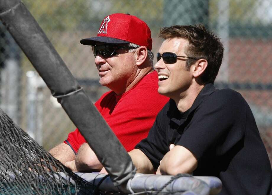 FILE - In this Feb. 20, 2014, file photo, Los Angeles Angels manager Mike Scioscia, left, and general manager Jerry Dipoto watch batting practice during baseball spring training in Tempe, Ariz. Dipoto resigned Wednesday, July 1, 2015, abruptly ending his 3 1/2-year tenure with the club amid apparent tensions with Scioscia. Former general manager Bill Stoneman will take over as the interim GM for the rest of the season, the Angels announced. (AP Photo/Rick Scuteri, File) Photo: Rick Scuteri