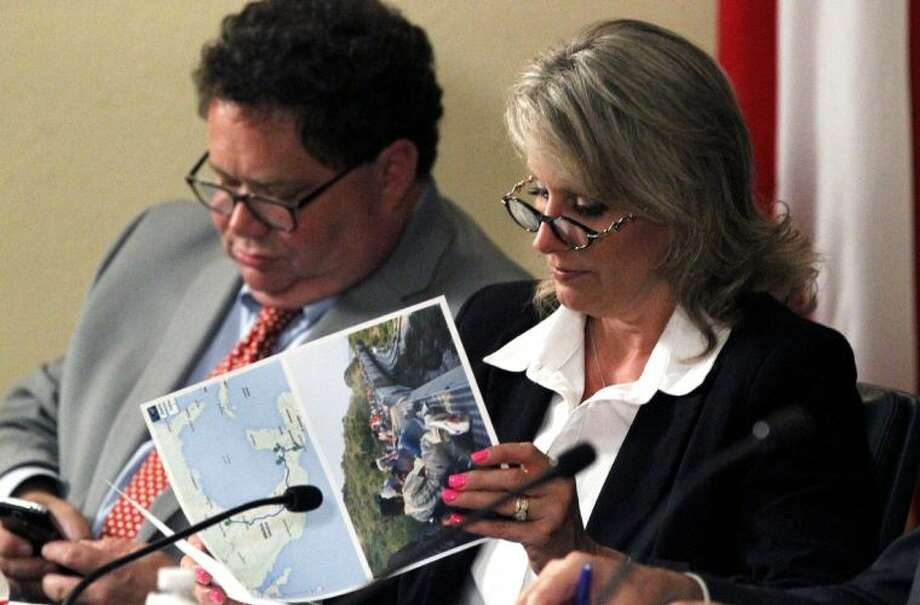 Congresswoman Renee Ellmers looks at photos provided by Hidalgo County Judge Ramon Garcia about the recent influx of undocumented minors at the U.S.-Mexico border Thursday.