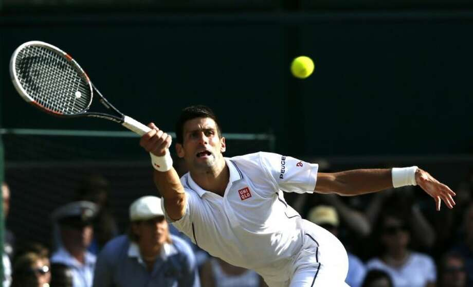 Novak Djokovic of Serbia defeated Roger Federer in five sets in the Wimbledon men's finals on Sunday. Photo: Ben Curtis