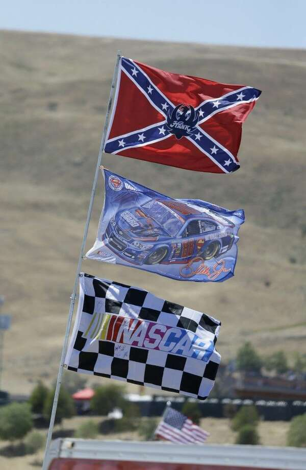 A number of flags, including a Confederate themed one, fly atop RV's in a campground outside the track during practice for the NASCAR Sprint Cup Series last Friday in Sonoma, Calif. Photo: Eric Risberg