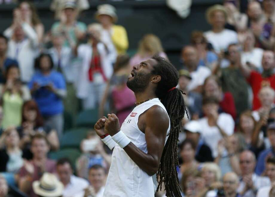 Dustin Brown of Germany, gestures after defeating Rafael Nadal of Spain, during their singles match, at the All England Lawn Tennis Championships in Wimbledon, London, Thursday. Photo: Pavel Golovkin