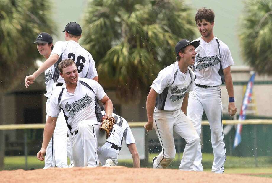Covenant Christian players celebrate after the Cougars' 1-0 win over Christian Harvest during a TAPPS state semifinal game at Baseball America Tuesday in Houston. Go to HCNpics.com to purchase this photos, and others like it. Photo: Jason Fochtman