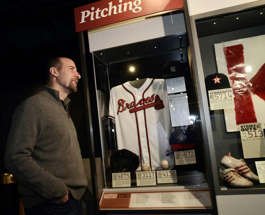 In this Feb. 3, 2015, file photo, former Atlanta Braves pitcher, John Smoltz, stands in front of the jersey he wore during his 3,000th career strikeout on April 22, 2008, that is currently on display at the National Baseball Hall of Fame in Cooperstown, N.Y. When Smoltz is inducted into the Baseball Hall of Fame in three weeks, he'll be the first player immortalized in the shrine to have undergone Tommy John surgery. Photo: Heather Ainsworth
