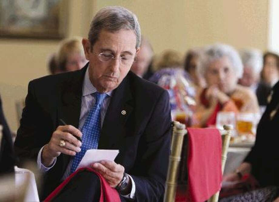 Texas Land Commissioner Jerry Patterson, who announced his candidacy for Lieutenant Governor, makes notes before speaking at the Montgomery County Republican Women's general meeting at the River Planation Country Club Thursday. / Conroe Courier