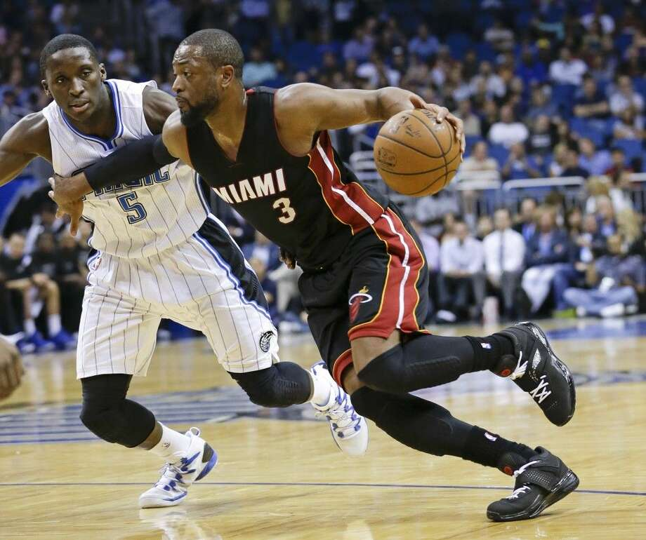 In this Feb. 25, 2015, file photo, Miami Heat's Dwyane Wade (3) goes to the basket past Orlando Magic's Victor Oladipo (5). Photo: John Raoux
