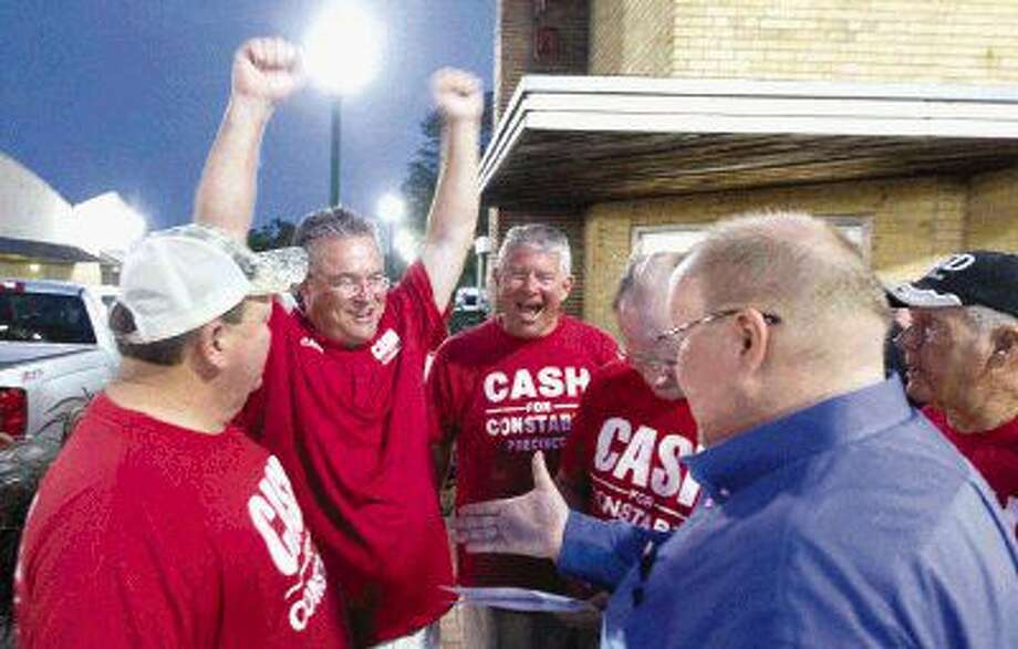 Philip Cash celebrates after winning the Precinct 1 constable's runoff election over Ike Fluellen Tuesday night. Photo: Jason Fochtman