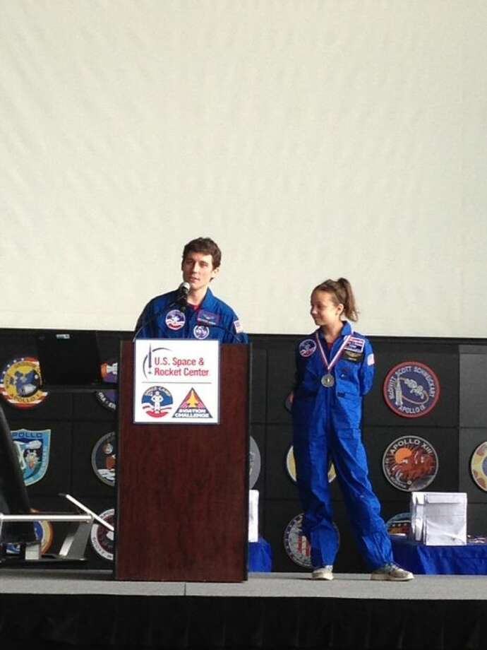 """Taylor Jones, right, who just completed fourth grade at A.R. Turner Elementary School in Willis, earned """"The Right Stuff Award"""" during Space Camp June 15-20 at the U.S. Space and Rocket Center in Huntsville, Ala."""