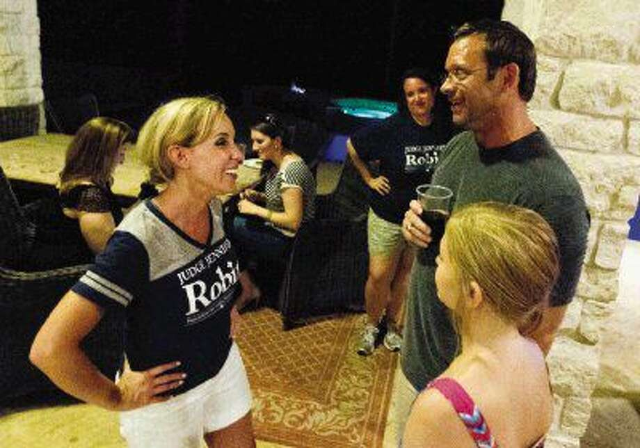 Jennifer Robin visits with supporters after defeating Kristin Bays for judge of the 410th state District Court Tuesday.