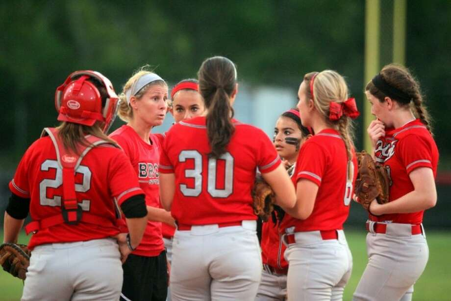 Clear Brook head softball coach Ashley Pillow talks to her team during a recent game. The Lady Wolverines have battled through a tough district schedule to earn a playoff berth. Photo: KAR HLAVA